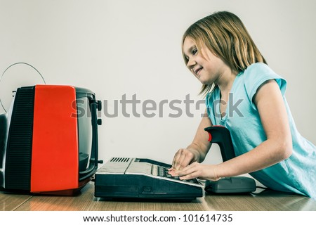 Girl playing on vintage television gaming equipment in home