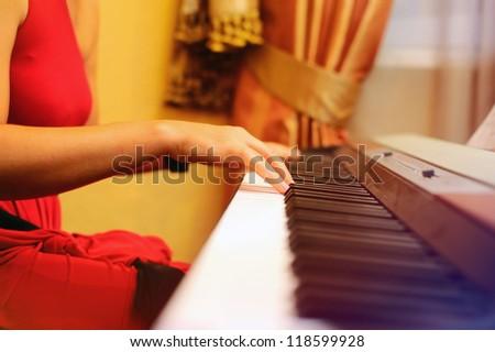 Girl playing the piano, hands closeup
