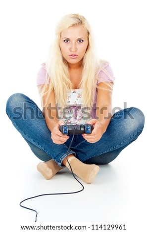 girl playing video games on the joystick