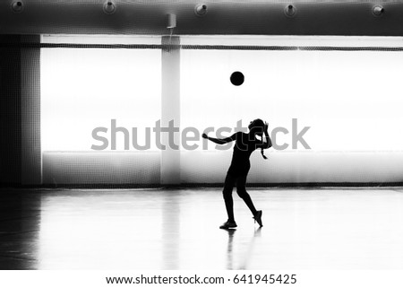 Girl playing volleyball in the sports club #641945425