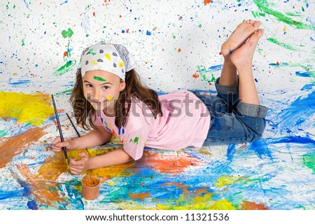Girl playing with painting with the background painted