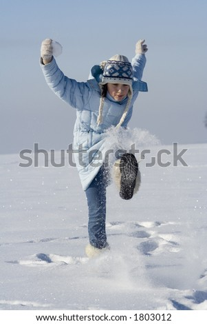 Girl playing with snowflakes