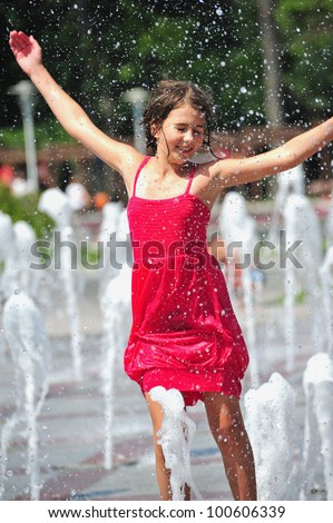 Girl playing with water in park
