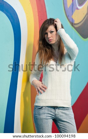 Girl portrait against a colorful wall.
