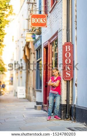 Girl portrait near bookshop in Cambridge, United Kingdom #1524780203