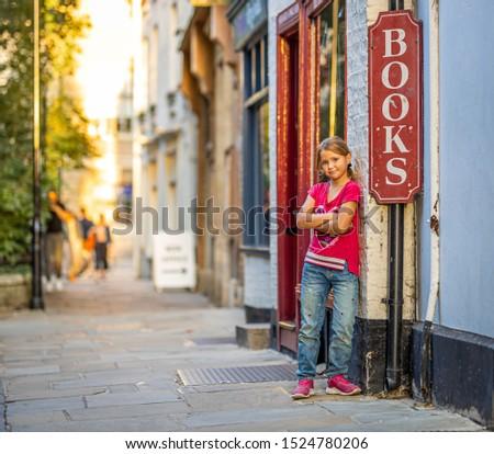 Girl portrait near bookshop in Cambridge, United Kingdom #1524780206