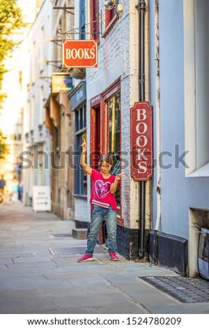 Girl portrait near bookshop in Cambridge, United Kingdom #1524780209