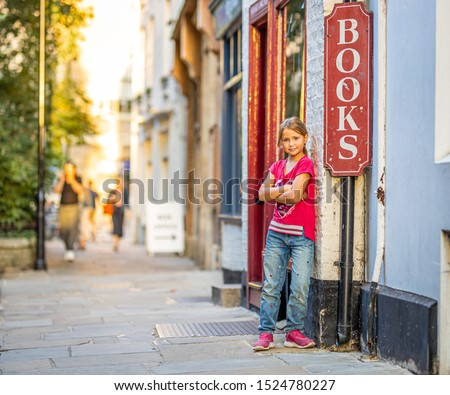 Girl portrait near bookshop in Cambridge, United Kingdom #1524780227