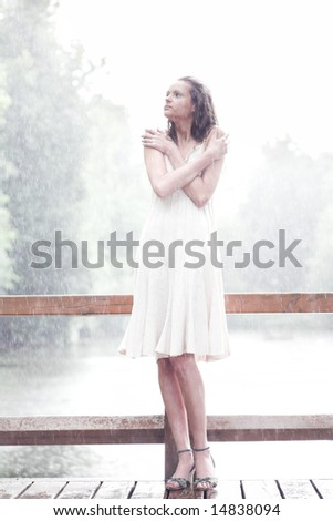 Girl portrait stay under rain drops