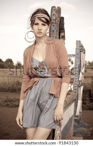girl poses on a hippodrome - stock photo