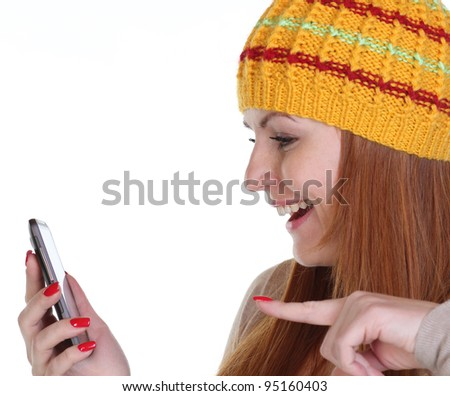 Girl posing for a photograph taken from his cell phone