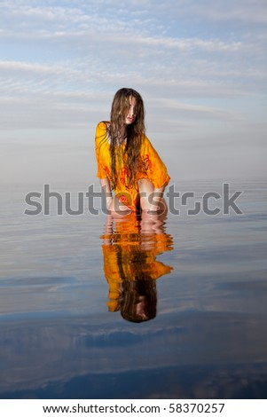 girl posing in the Water at sunset, real water, not photoshop-effect