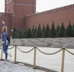girl posing on a background of red square in Russia