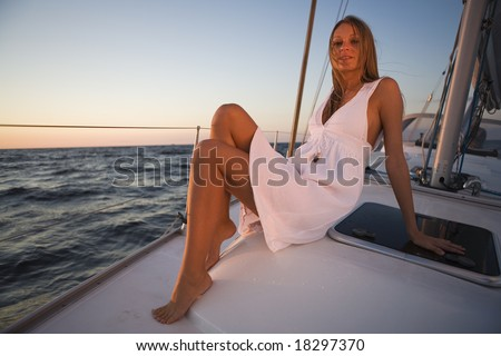 girl posing on a yacht