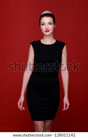Girl  posing over red background/Pretty young caucasian woman on Fashion theme