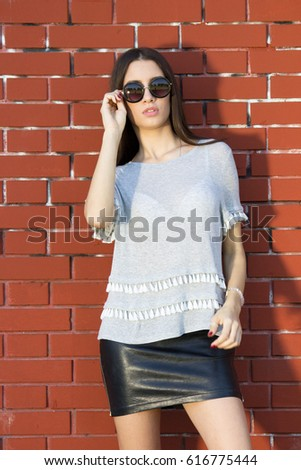girl posing with sunglasses #616775444
