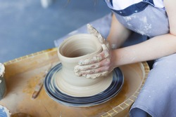 Girl potter's hands close up. Pottery production historical reconstruction.