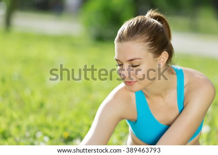 Girl practicing stretching exercises - Shutterstock ID 389463793