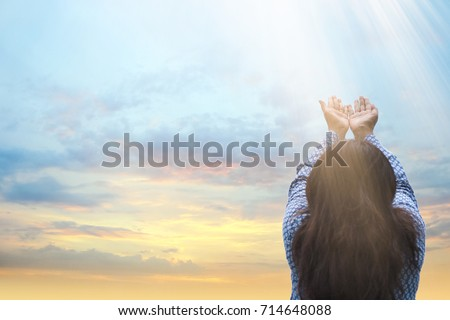 Girl praying and worship to GOD.woman praying to GOD in the morning.teenager woman hand praying,Raised Hands in prayer on the sky in the morning concept for faith, spirituality and religion.