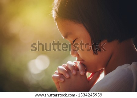 Girl praying hand faith jesus promise Pray for god blessing wishing have better life Christians together with flare sunlight at sunset #1534245959