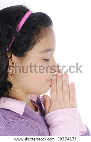 Girl praying, isolated on white