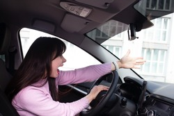 Girl presses on the hoot of the car, a stressful situation on road