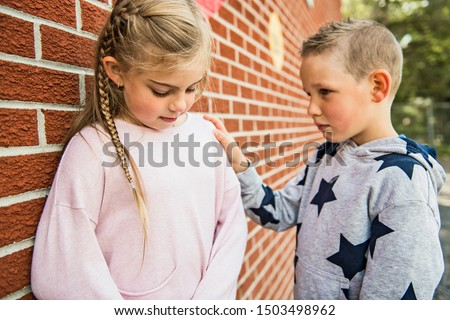 girl problem at school, sitting and consoling child each other