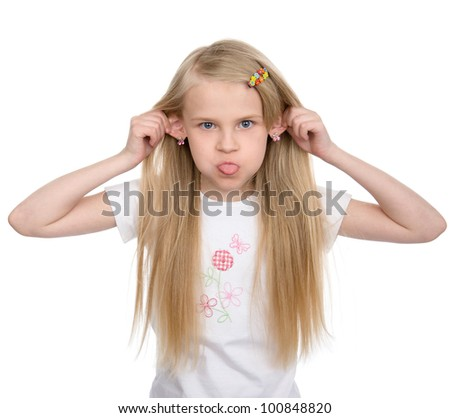 girl pulling faces. isolated on white background