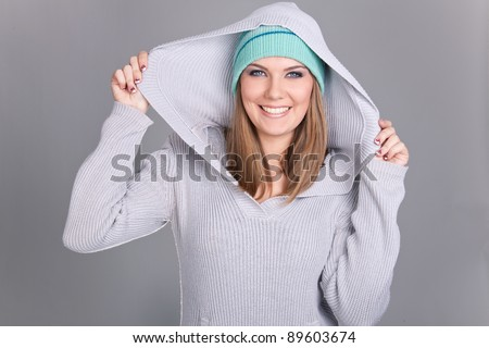 girl pulling   her hood sweater, funny winter girl