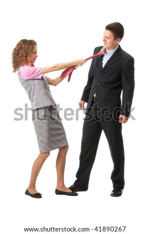 Girl pulls a man in a tie. Isolated over white