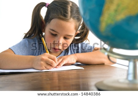 girl pupil sitting by the table with globe Isolated on white