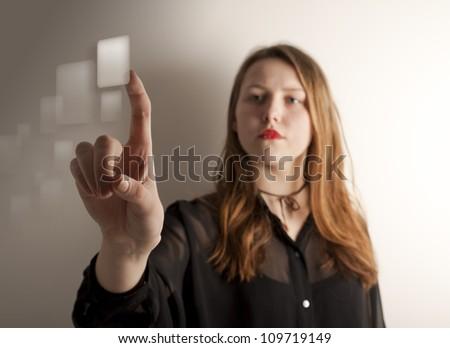 Girl pushing the virtual button