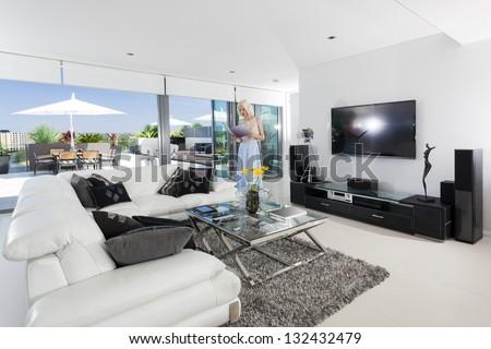 Girl reading in luxury living room