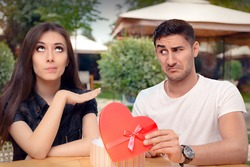 Girl Refusing Heart Shaped Gift From Her Boyfriend - Materialist girlfriend refusing a present from her loved one