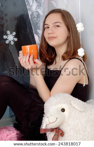 girl relaxed at home in winter holiday and enjoy a warm drink