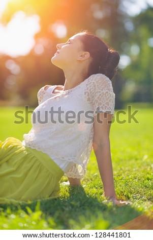Girl relaxing on meadow