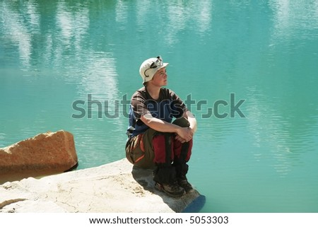 Girl relaxing on mountains lake