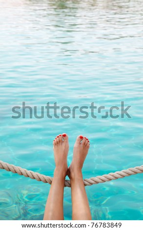 girl relaxing on the beach near the sea - stock photo