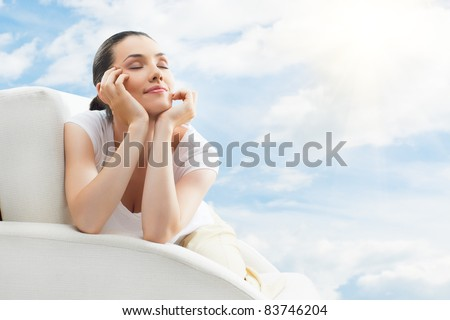 Girl relaxing on the couch - stock photo