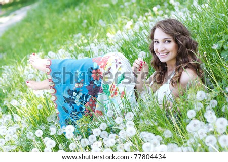 Girl resting in the dandelion field