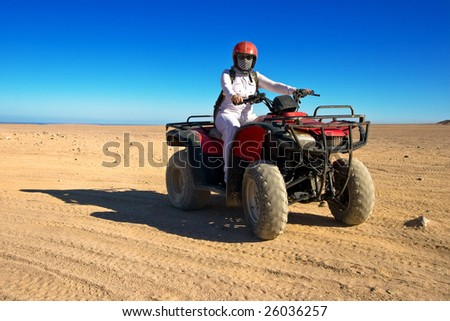 girl rides on the quad