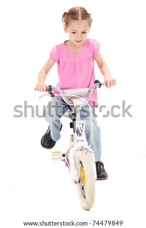 Girl riding bicycle. Isolated on white
