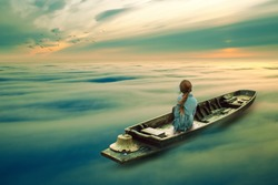 girl riding boat in a mist ocean