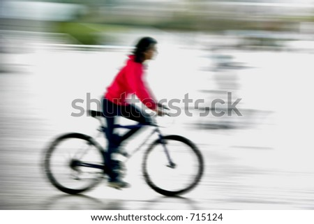 Girl riding is bike in motion effect