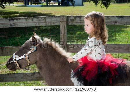 Girl Riding Miniature Horse