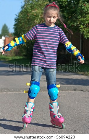 girl riding on roller blades during summer holidays