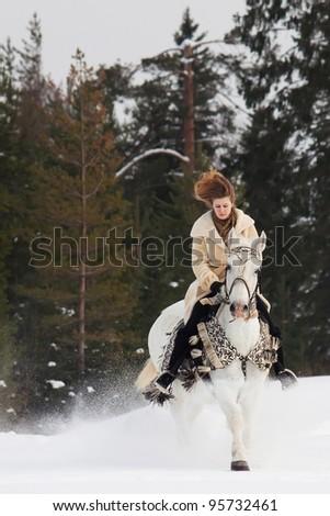 Girl riding Orlov horse at winter day