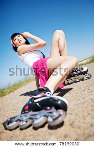 Girl rollerblading, playing sports on the
