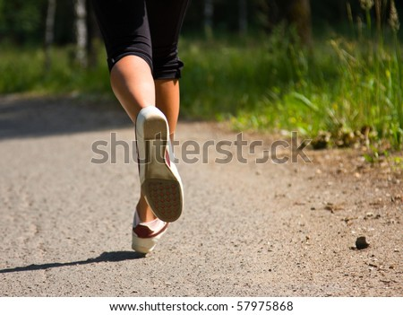 Girl running in the park. Active woman running. A confident female runner has the stamina to conquer all. - stock photo