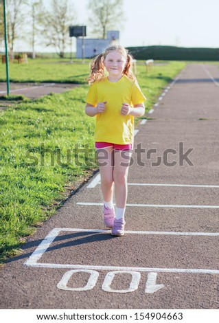 girl running on track